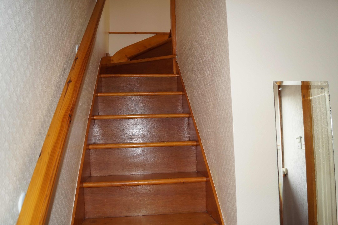 stairs leading to attic bedroom