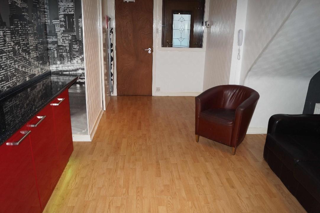 Lounge area open plan kitchen